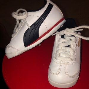 White,blue, and red Pumas Toddler size 6